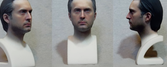 A Light Skinned and Dark haired Adult Male Head Bust Created With 123D and ZBrush. It is in color.