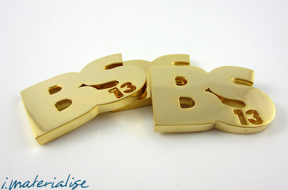 A photo of golden colored 3D printed brass metal.