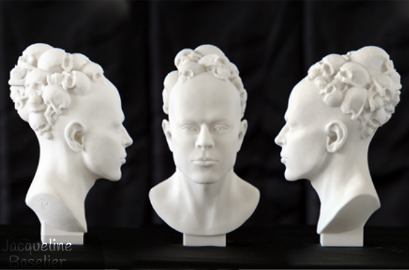A bust of a bald human head covered with skulls. This asymmetrical design is 3D printed in resin and hand-finished.