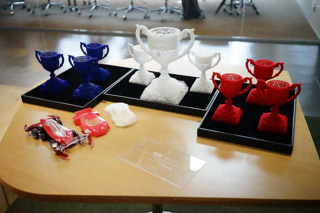 3D-printed trophies in blue, white and red, the iconinc colors of TAMIYA, the famous Mini 4WD producer in Japan