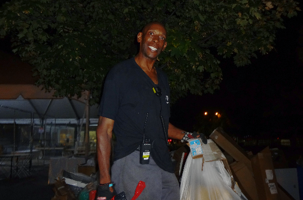 An image of one of the janitors smiling brightly