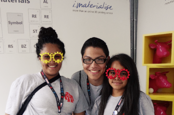 Maker Faire New York 2014: tween girl wearing 3D printed red polyamide glasses at our booth: three teenagers from New York
