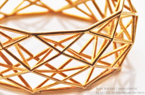 "Photo of a golden colored brass bracelet by MCODE. This piece is called ""Brass Bracelet Constructionist"" by MCODE, courtesy of Maaike van der Horn."