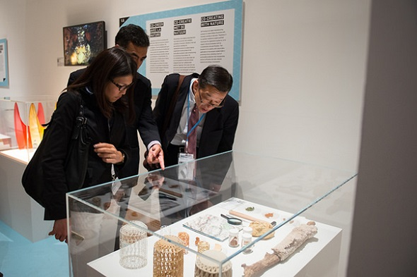 Visitors look at the CaCO3 Stoneware pieces by Laura Lynn Jansen and Thomas Vailly. © Wim Gombeer
