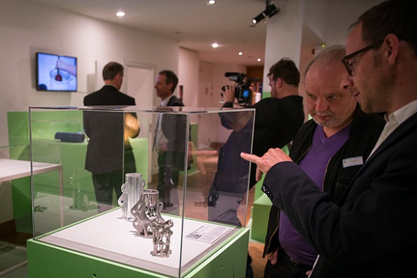 One room of the exhibit reveals how 3D printing changes manufacturing processes. © Wim Gombeer