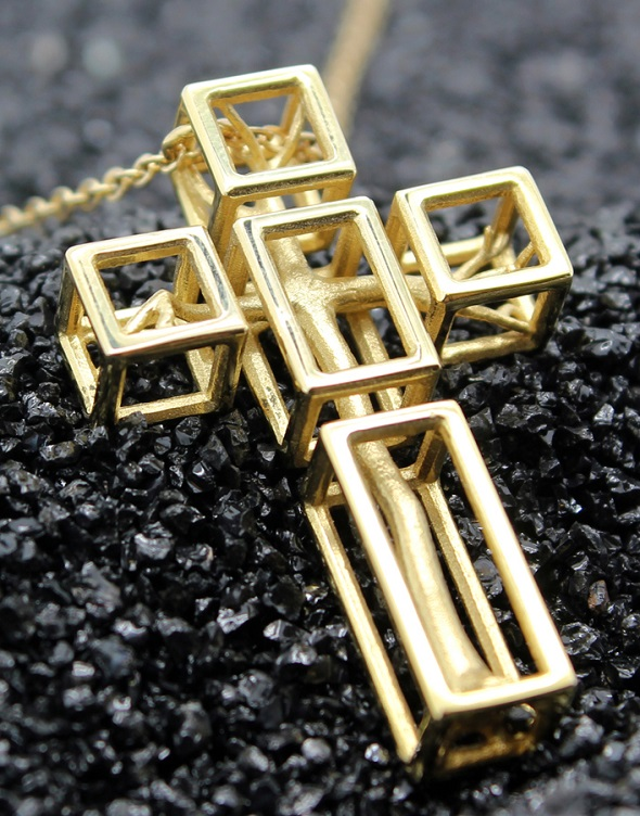 Gold plated brass 3D print of the 'Tree in a Cross Pendant' by Desmond Chan.
