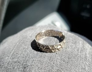 Detailed view of the custom-made 3D printed white gold wedding band