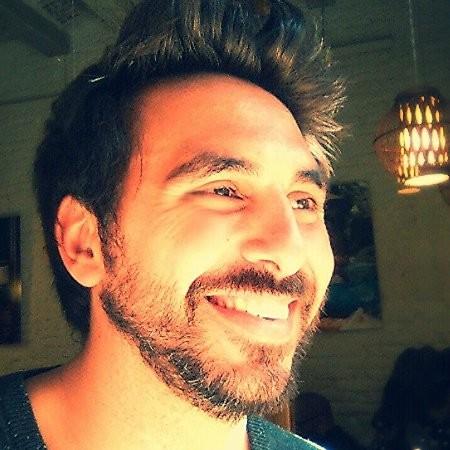 Image of a man who works at PAL Robotics smiling