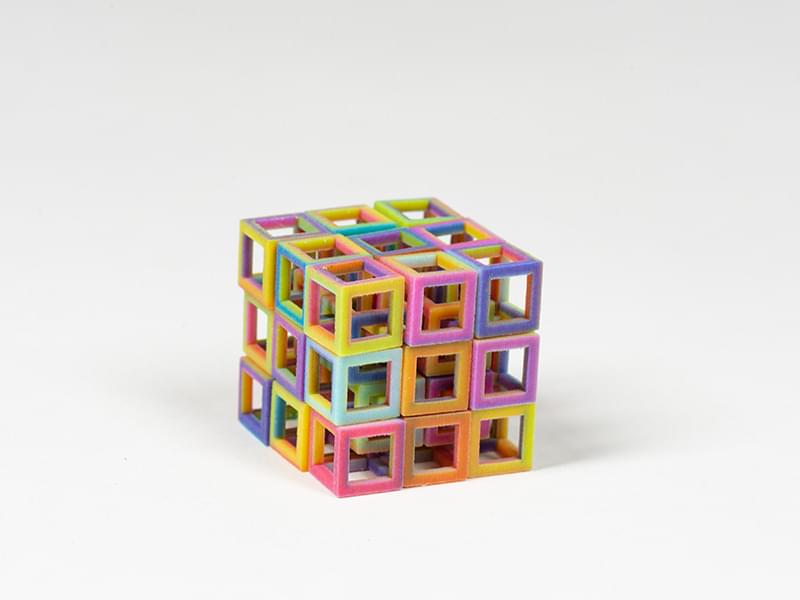 A 3D-printed cube made of individual cubes made of Multicolor+.
