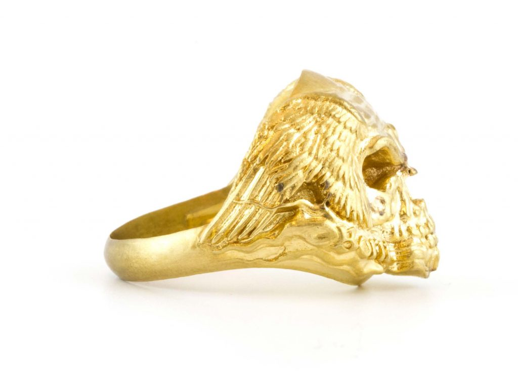 A 3D-printed ring made of gold with eagle wings.