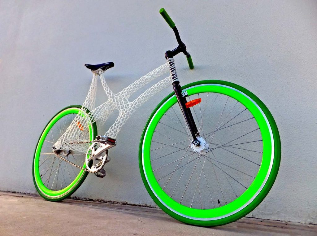A bicycle with a white 3D printed frame.