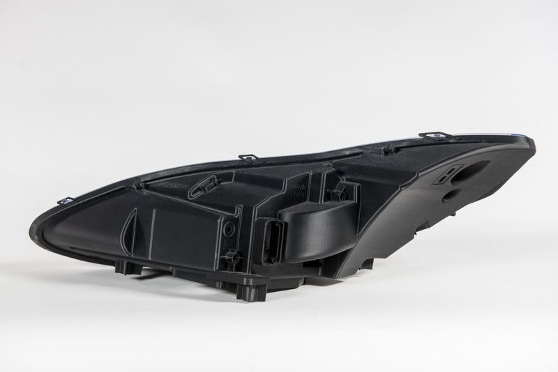 An image of a black Aston Martin headlight prototype printed with FDM.