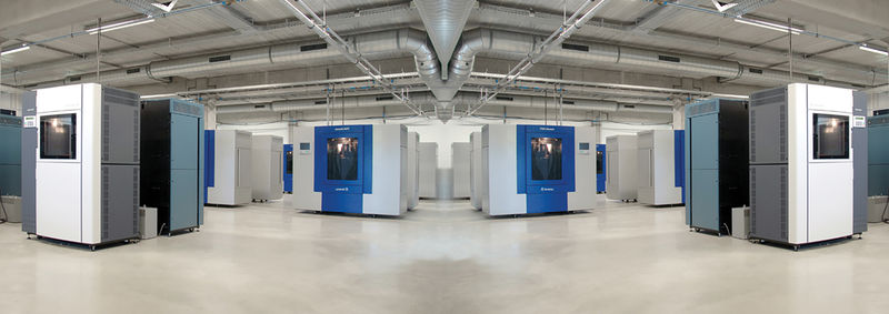 A panoramic image of the industrial FDM machines at Materialise.